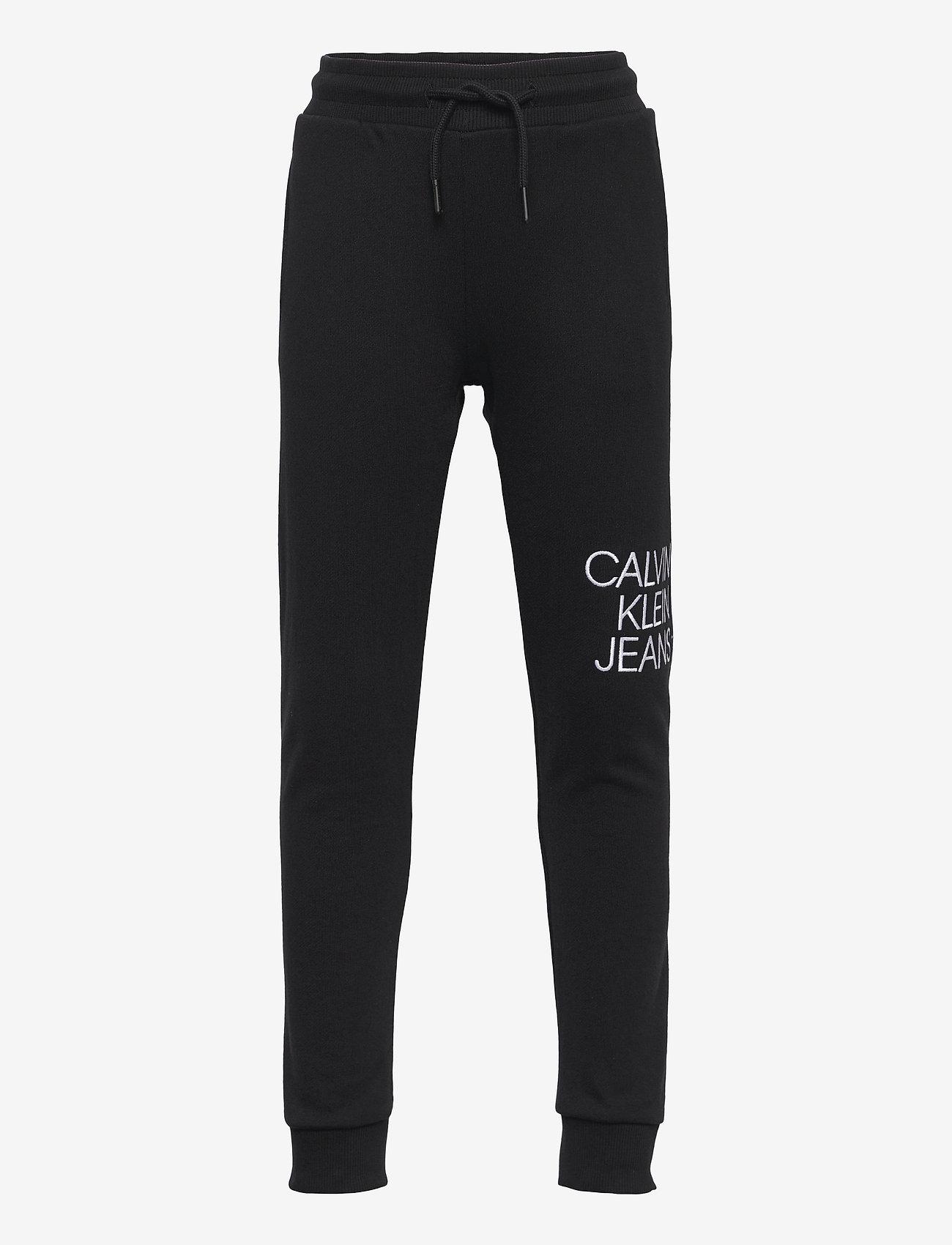 Calvin Klein - HYBRID LOGO SWEATPANTS - jogginghosen - ck black - 0
