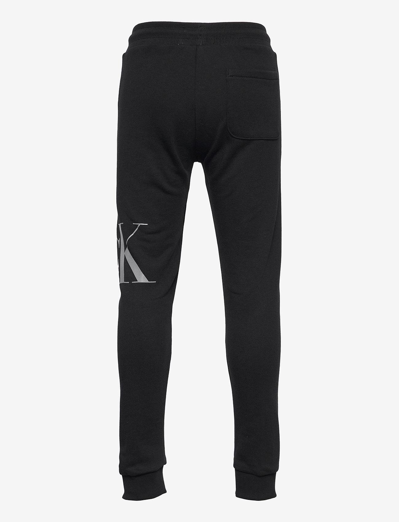 Calvin Klein - HYBRID LOGO SWEATPANTS - jogginghosen - ck black - 1