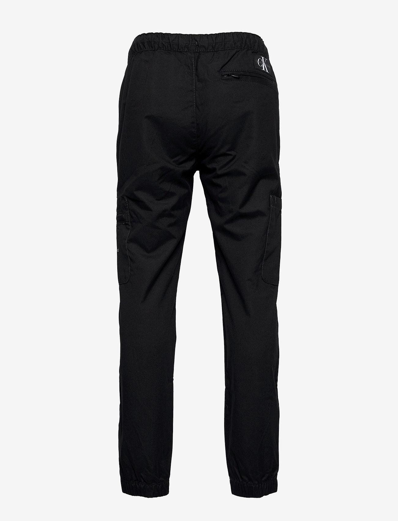 Calvin Klein - FUNCTIONAL POCKET PANTS - trousers - ck black - 1