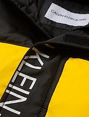 Calvin Klein - COLOUR BLOCK PUFFER JACKET - puffer & padded - bold yellow - 3