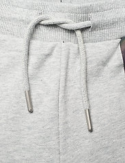 Calvin Klein - REFLECTIVE LOGO SLIM FIT PANTS - jogginghosen - light grey heather - 3