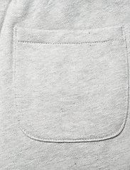 Calvin Klein - REFLECTIVE LOGO SLIM FIT PANTS - jogginghosen - light grey heather - 4