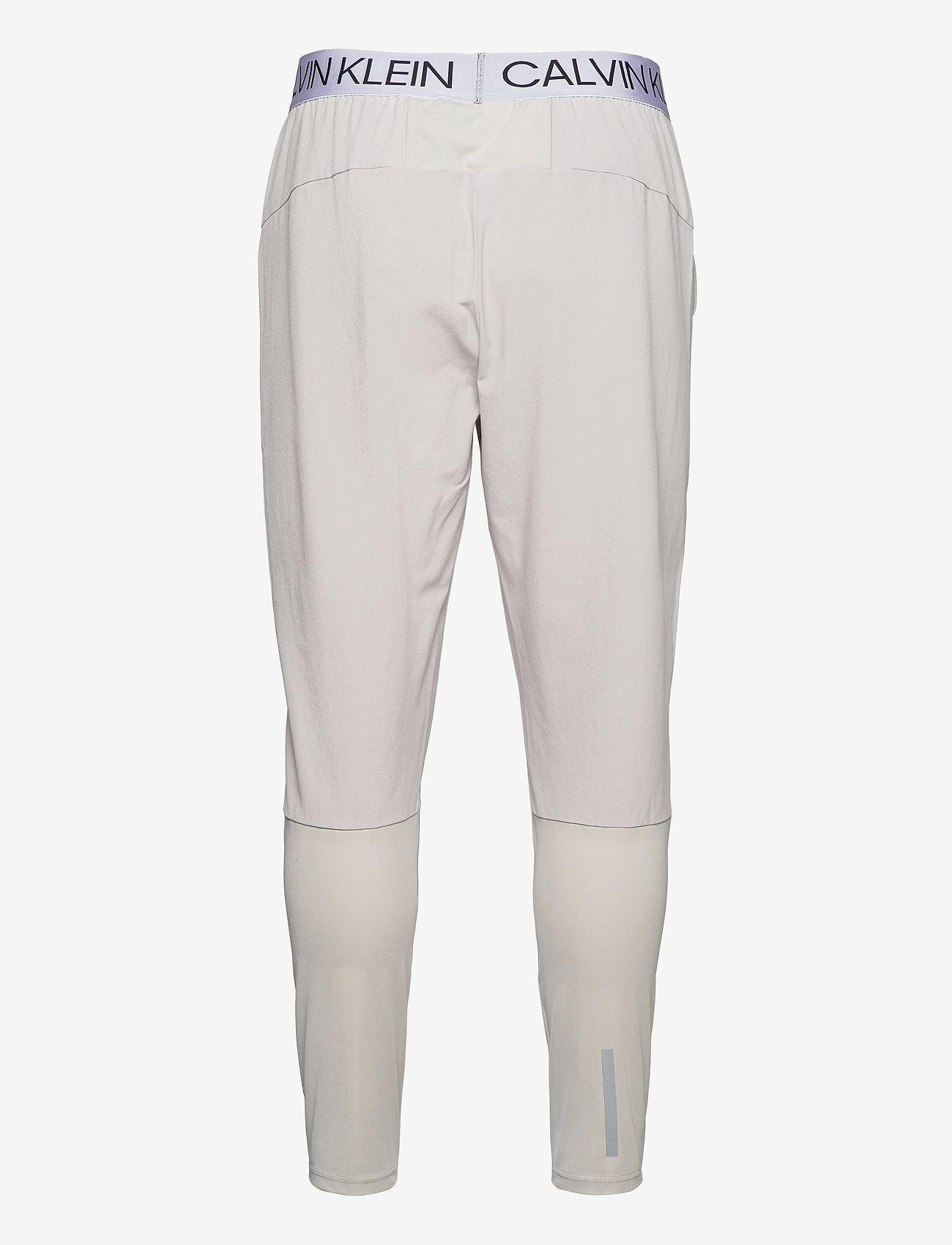 Calvin Klein Performance - WO - MIX FABRIC PANT - spodnie treningowe - cloud nine - 1