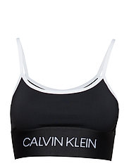 ae5c0788b143b Calvin Klein Performance. Strappy sports bra ...