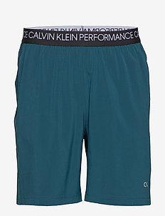 WOVEN SHORT - training shorts - majolica blue/ck black/bright