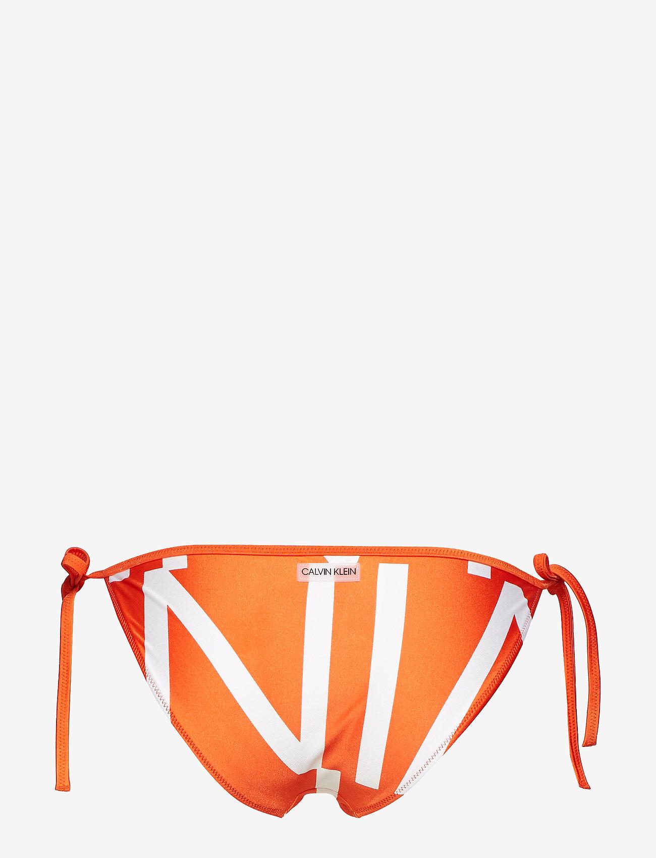 Calvin Klein STRING SIDE TIE - Stroje kąpielow KLEIN ABSTRACT MANDARIN RED - Kobiety Odzież.