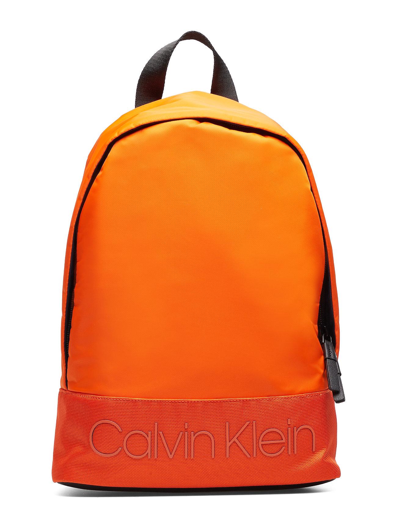 Calvin Klein SHADOW ROUND BACKPAC - ORANGE PEEL
