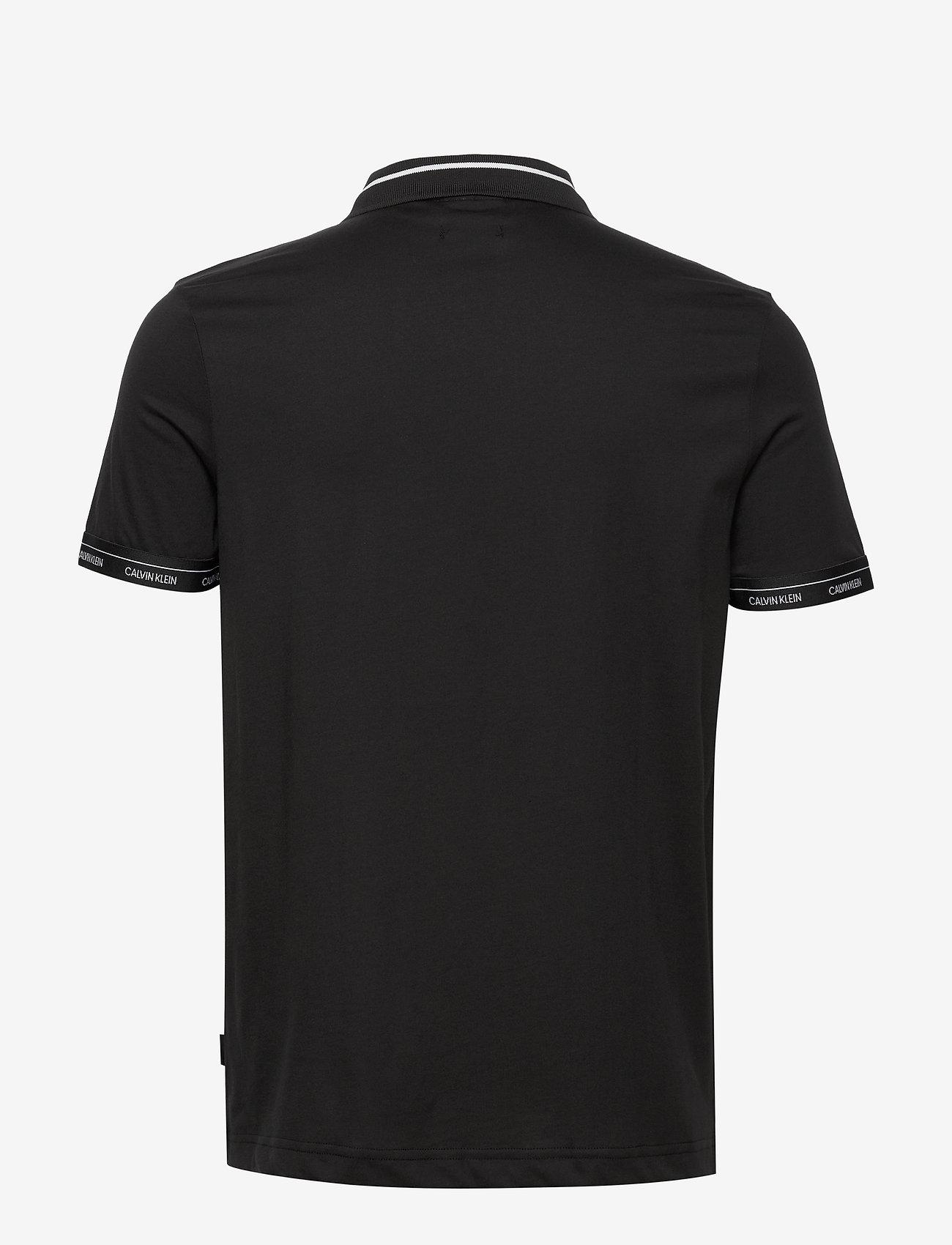 Calvin Klein - LIQUID TOUCH LOGO CUFF POLO - polos à manches courtes - ck black - 1