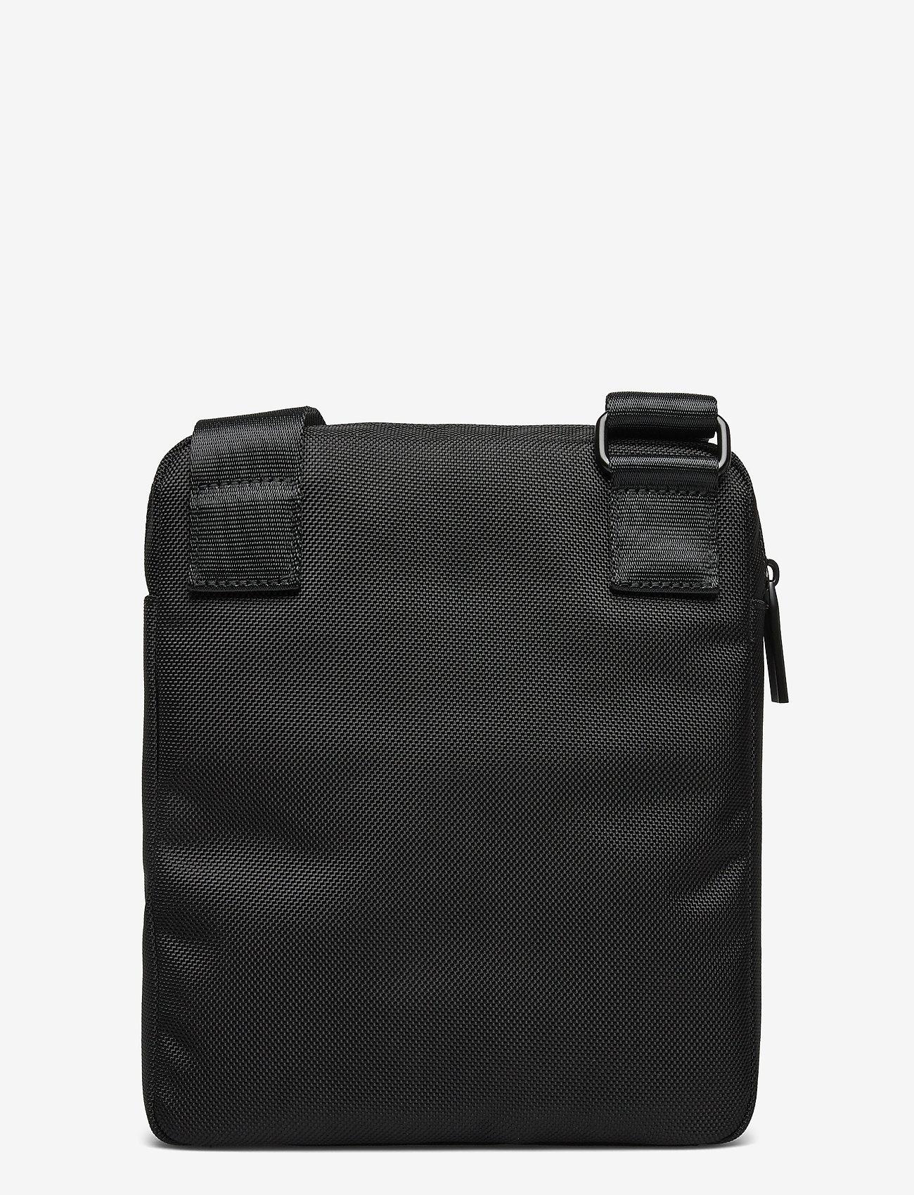 Calvin Klein - ULTIMATE NYLON FLAT - sacs à bandoulière - black - 1