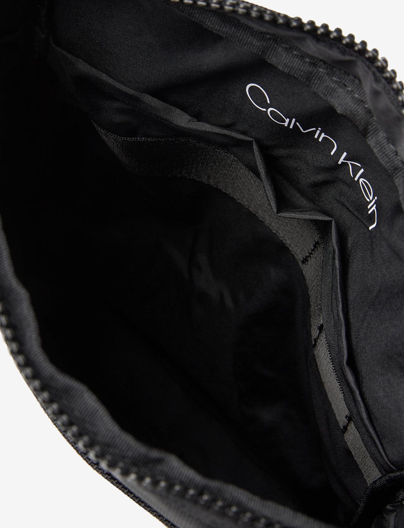 Calvin Klein - ULTIMATE NYLON FLAT - sacs à bandoulière - black - 4