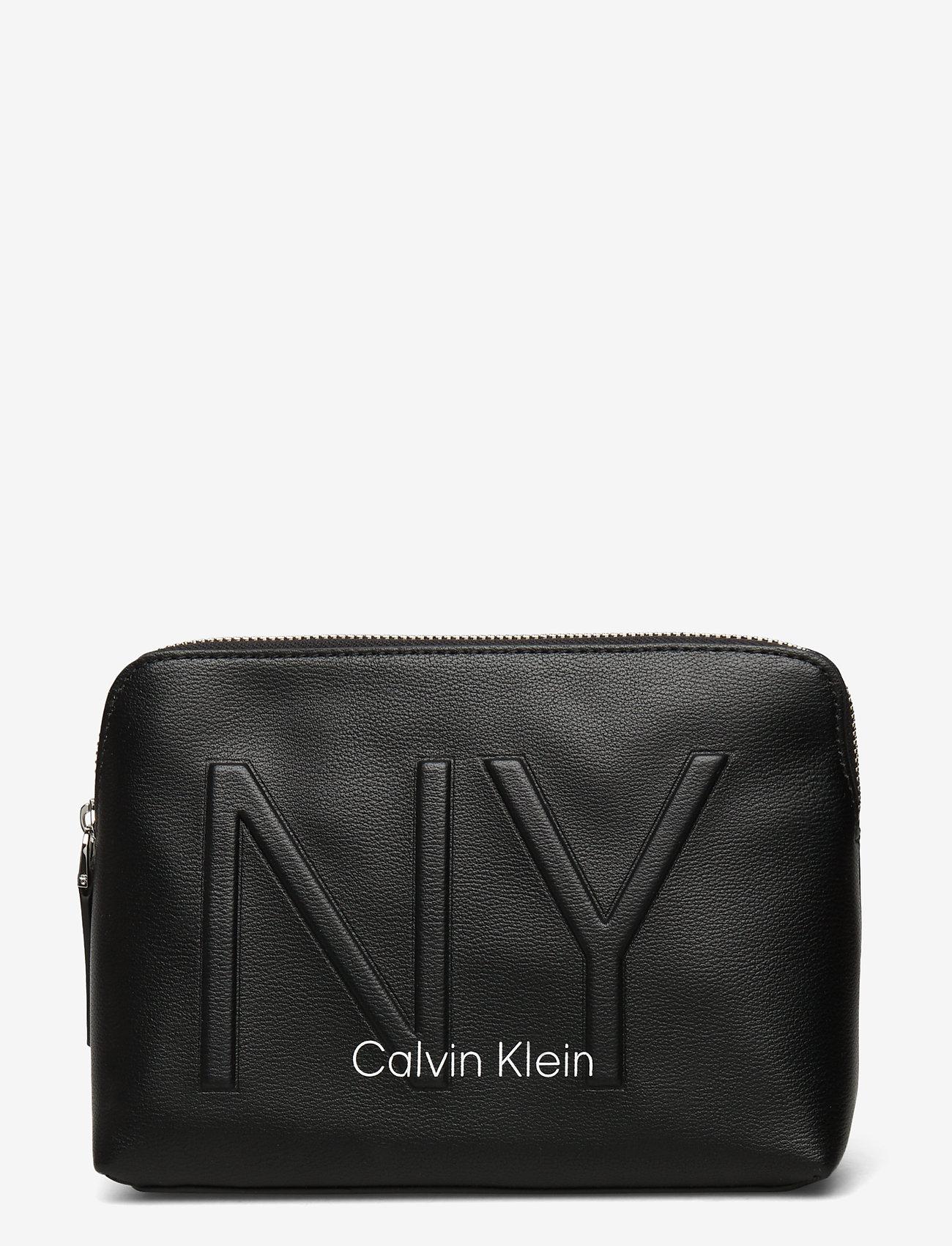 Calvin Klein - NY SHAPED WASHBAG - torby kosmetyczne - black - 0