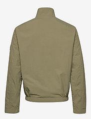 Calvin Klein - CRINKLE NYLON BLOUSO - light jackets - delta green - 2