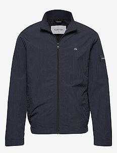 CRINKLE NYLON BLOUSO - light jackets - calvin navy