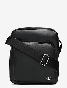REPORTER W/ZIP PCKT - shoulder bags - black