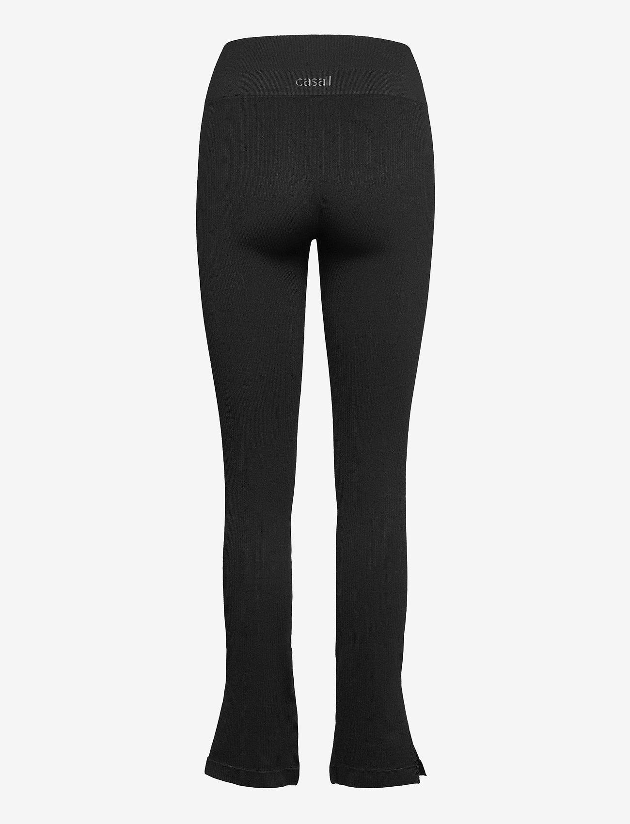 Casall - Seamless Rib Slit Pants - spodnie treningowe - black - 1