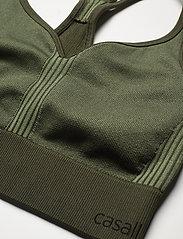 Casall - Seamless sports top - sport bras: low - northern green - 2