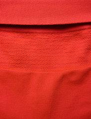 Casall - Seamless Blocked Tights - running & training tights - impact red - 2