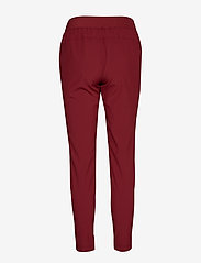 Casall - Slim woven pants - pantalon de sport - moving red - 1