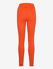 Casall - Shiny Matte Seamless Tights - running & training tights - intense orange - 1