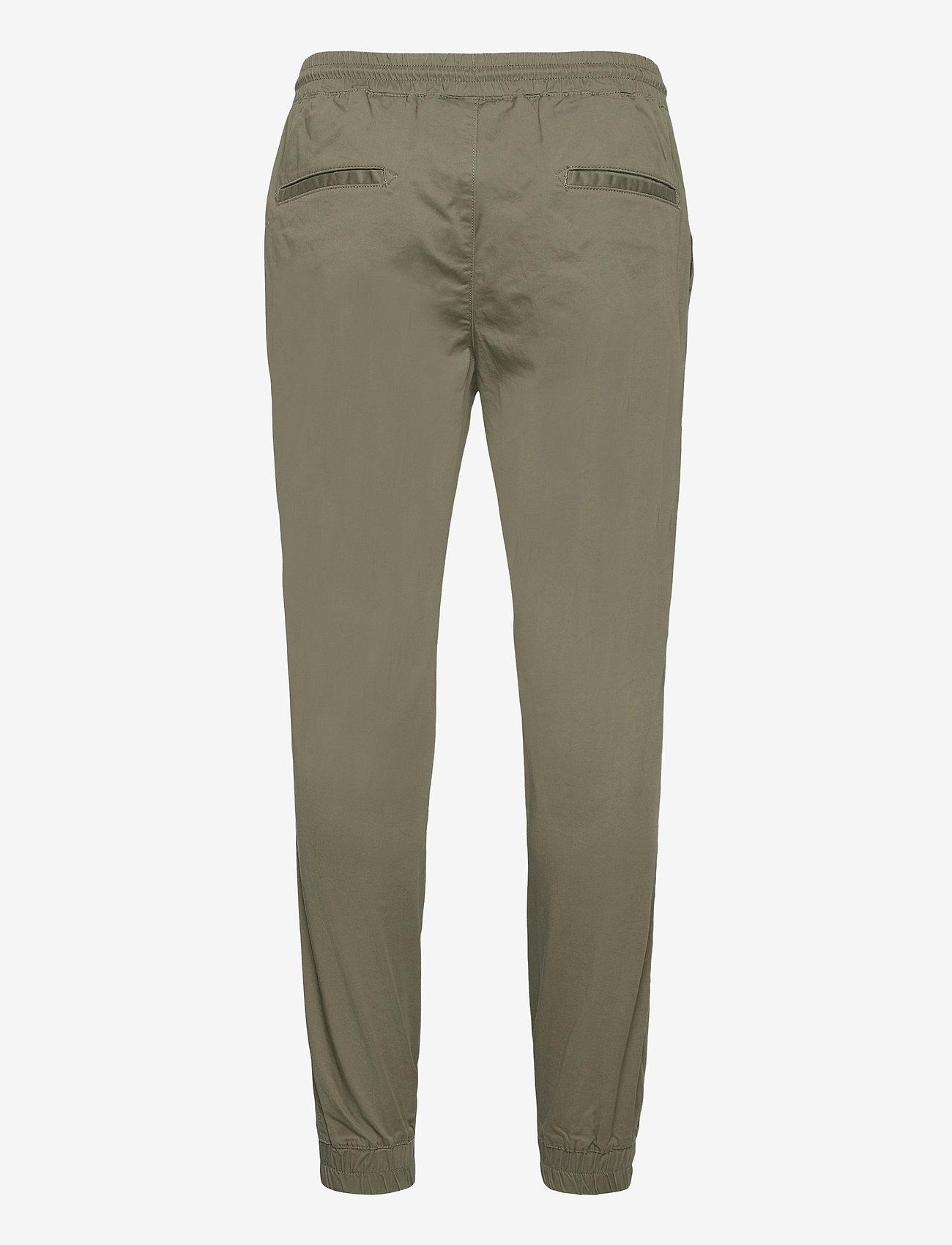Champion - Elastic Cuff Pants - treenihousut - deep lichen - 1