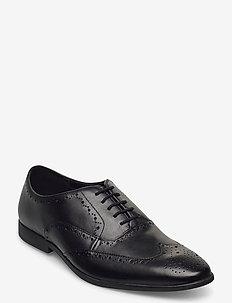 Bampton Rhodes - monks - black leather