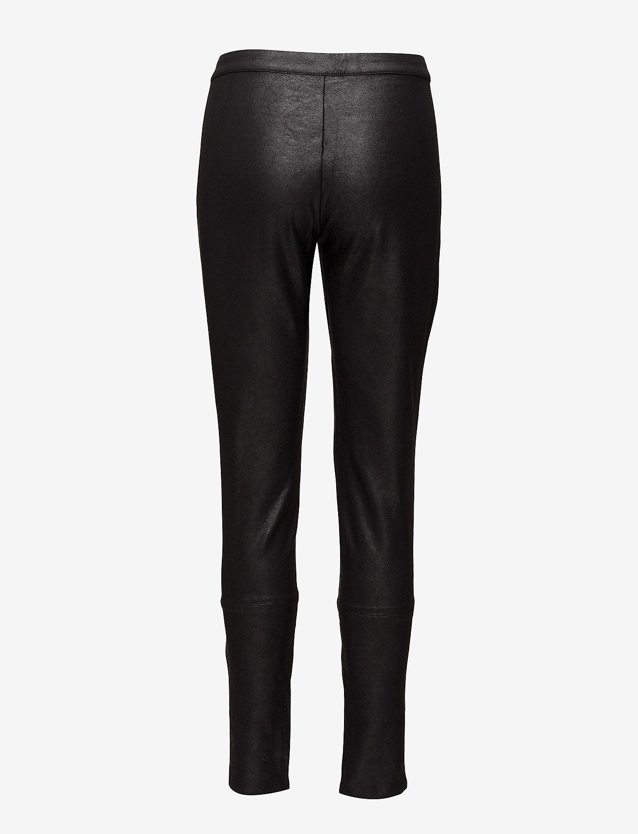 Coster Copenhagen - Coated leggings - pantalons slim - black