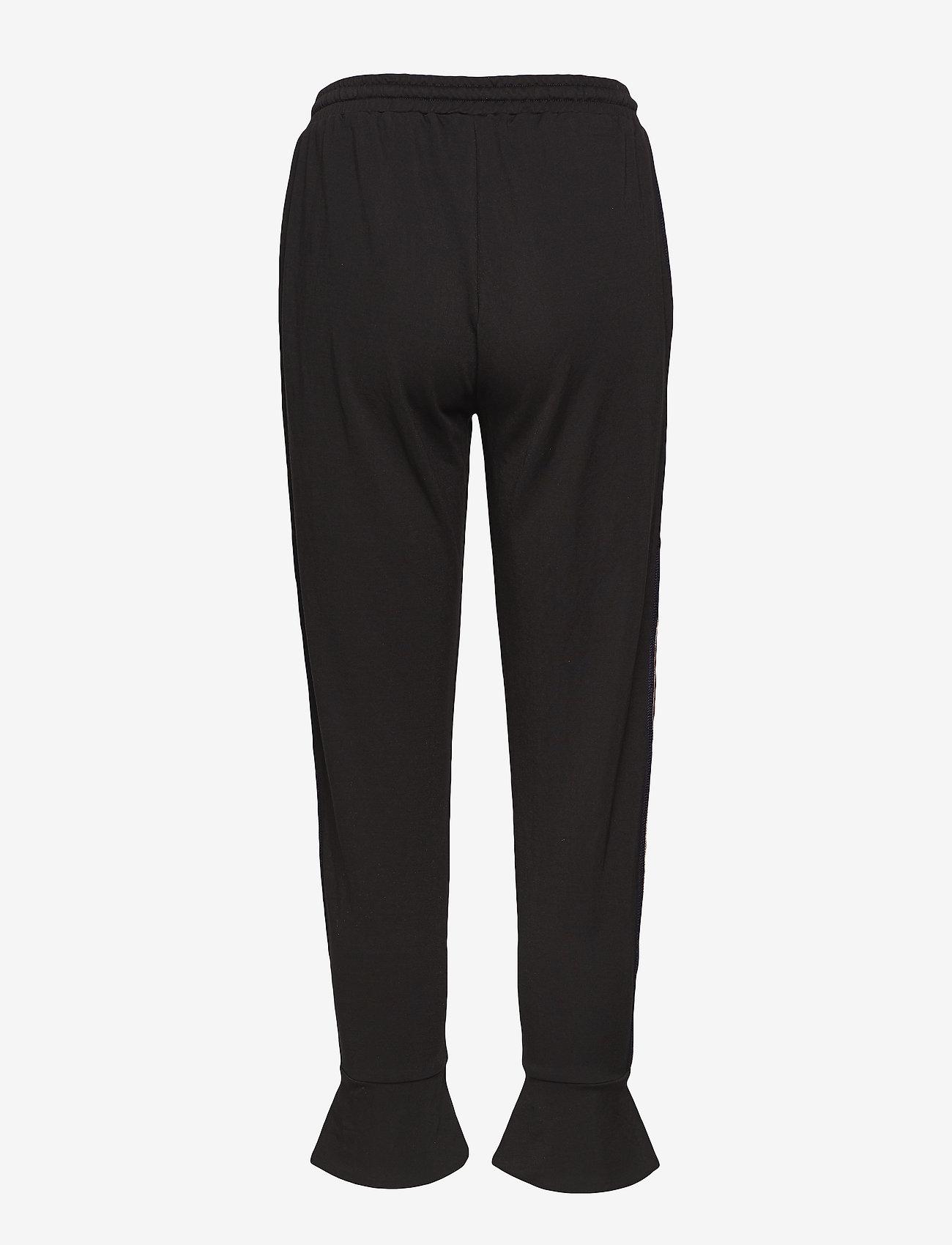 Coster Copenhagen - Sweatpants w. volant cuff - sweatpants - black - 1