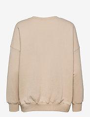 Coster Copenhagen - CC Heart oversize sweatshirt - Orga - sweatshirts & hættetrøjer - vanilla - 1