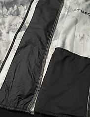 Craft - PRO GLOW IN THE DARK LUMEN JKT W - training jackets - p nova/black - 5
