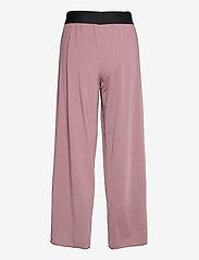 Craft - FLOW SPLIT PANTS W - sportbroeken - dull purple - 1