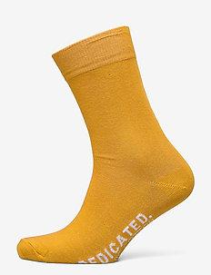 Socks Sigtuna Dedicated Logo - reguläre strümpfe - golden yellow