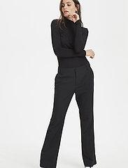 Denim Hunter - 14 THE BLACK FLARED PANT - bukser med brede ben - black - 0