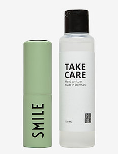 TAKE CARE Hand Sanitizer 100 ml + Bag size dispenser - hand sanitizers - green 7494c