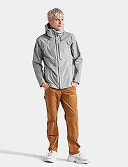 Didriksons - OVE USX JKT - rainwear - stone grey - 7