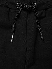 Diesel - PELINA TROUSERS - trousers - nero - 5