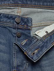 Diesel Men - LARKEE-X L.34 TROUSERS - relaxed jeans - denim - 3