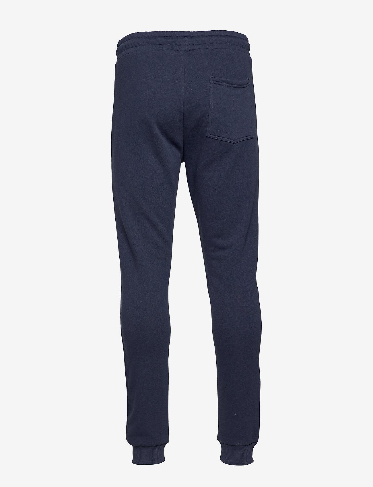 FILA - MEN EDAN sweat pants - treenihousut - black iris - 1