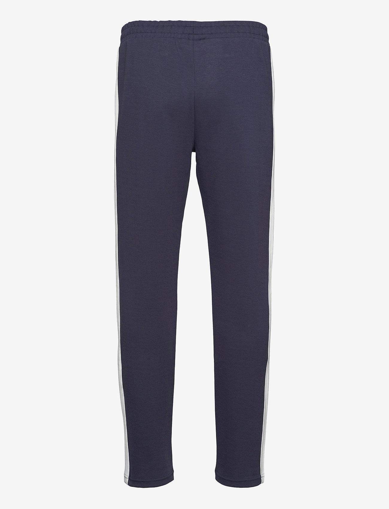 FILA - MEN SETTANTA track pants - treenihousut - black iris-blanc de blanc - 1