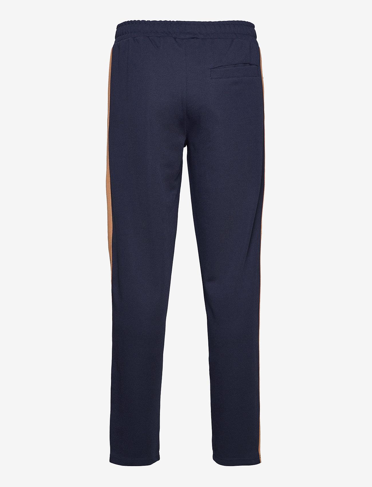 FILA - MEN HAVERD track pants - sale - black iris-hazel - 1