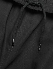 FILA - MEN CLEAVE cargo pants - pantalon cargo - black - 3