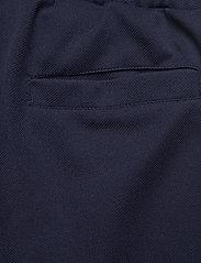 FILA - MEN HAVERD track pants - treenihousut - black iris-hazel - 5