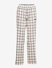 FILA - WOMEN TEVY AOP track pants - eggnog tartan allover - 0