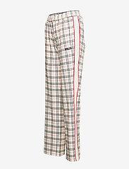 FILA - WOMEN TEVY AOP track pants - eggnog tartan allover - 2