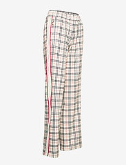 FILA - WOMEN TEVY AOP track pants - eggnog tartan allover - 3