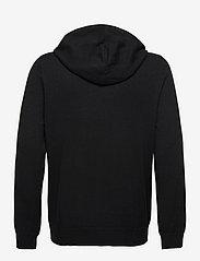 Filippa K - M. Arthur Knitted Hoodie - hoodies - black - 1