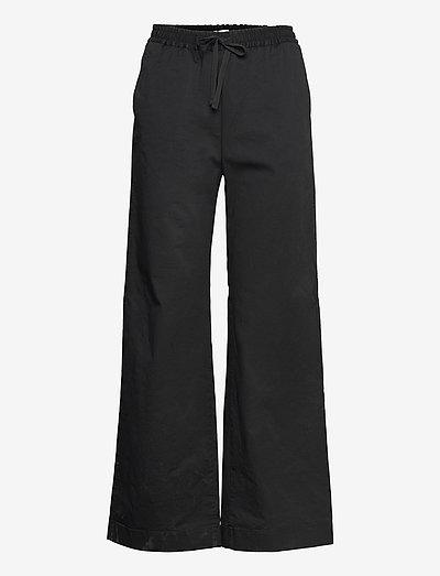 Gillian Trouser - leveälahkeiset housut - black
