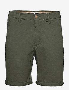 Bygdøy Shorts - spodenki chinos - deep lichen green
