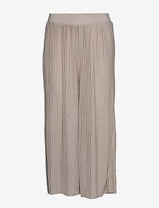 FRITPLISSE 2 Pants - wide leg trousers - tile sand
