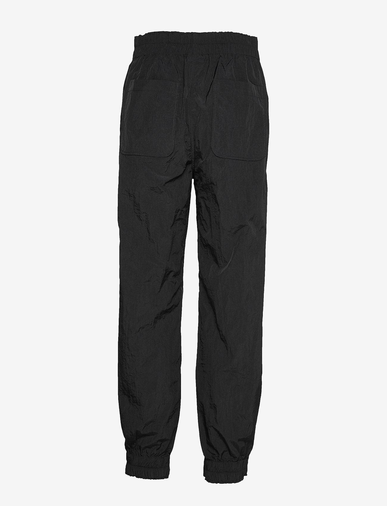 Ganni - Crinkled Tech - casual bukser - black - 1