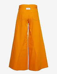 Ganni - Denim Runway - szerokie dżinsy - turmeric orange - 1